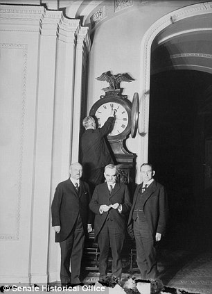 Then and now: Senate Sergeant-at-Arms Charles P Higgins turns the Ohio Clock for daylight savings time in 1918, left. Right, a modern picture of the clock