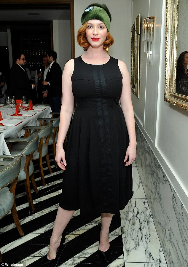 Little black dress: The Mad Men star showed off her curves in a simple frock at the fashionable dinner which was topped off by her quirky hat