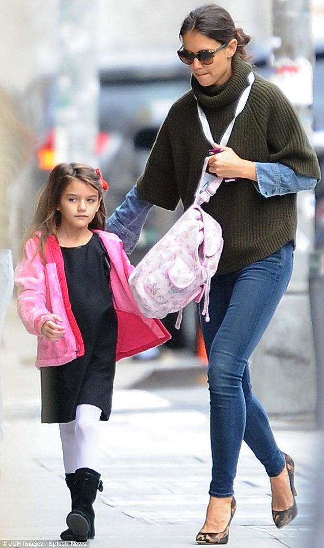 Going undercover: Katie Holmes wore camouflage high heels to drop Suri at school in New York on Friday