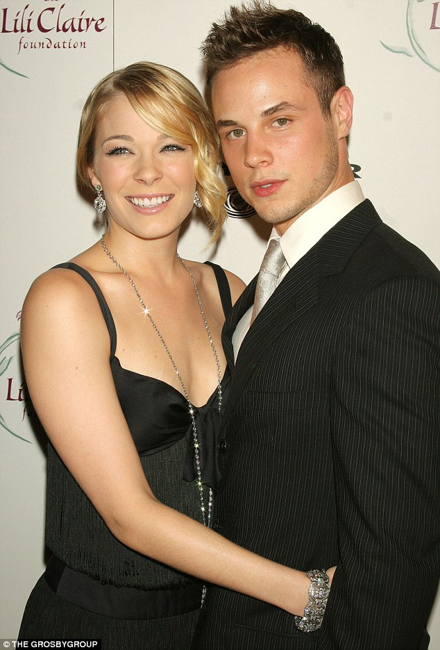 Once so happy: Dean Sheremet, pictured in 2005 with wife LeAnn Rimes, said on Thursday of her cheating, 'I never saw it coming'