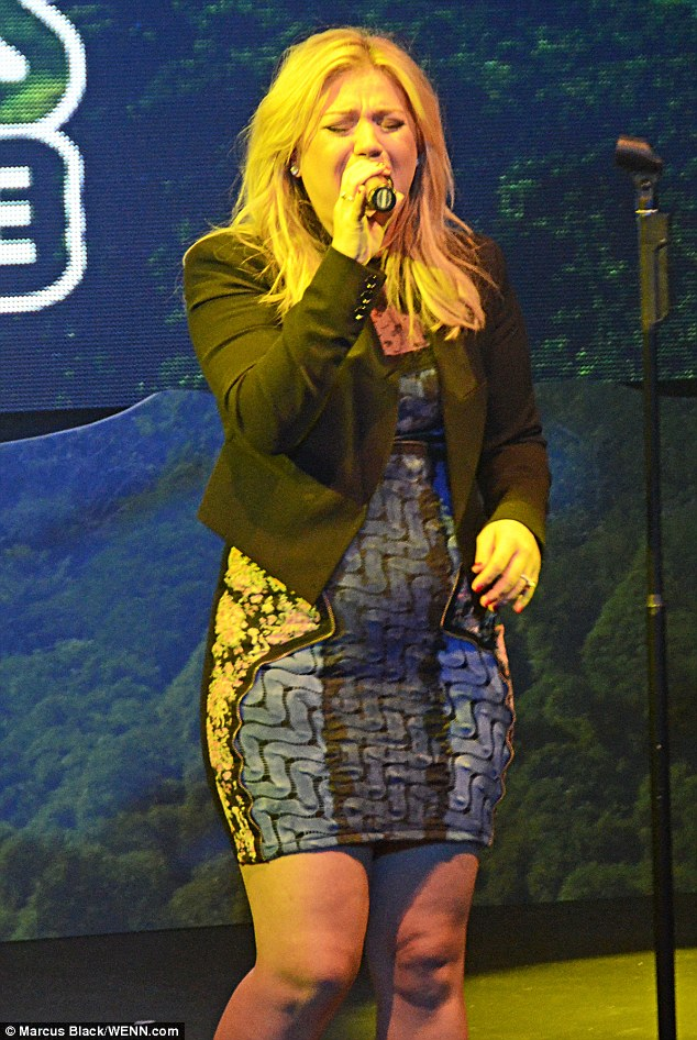 Not her best look: Kelly Clarkson donned an unflattering skintight dress for her performance at the Green Mountain Coffee Fair Trade 'People Like Us' event in New York city on Thursday