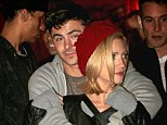 Zac Efron finally has something to smile about as he cosies up to new love interest Brittany Snow at Haunted Hayride in LA