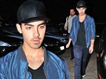 Poor Joe... Joe Jonas cut a lonesome figure as he stepped out in Los Angeles, California on Thursday
