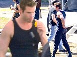 Liam Hemsworth throws himself into his work in wake of split from Miley and shows off his muscular arms on set of Mockingjay