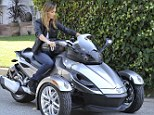Tomboy Stacy Keibler proves that three wheels are better than two when she hits the road on a Can-Am Spyder motorbike