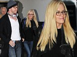 SPEC-tacular pair! Jenny McCarthy and beau Donnie Wahlberg sport matching glasses as they arrive hand-in-hand at the airport