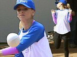 Sarah Michelle Gellar is in a playful mood on set as she films baseball game scenes for new comedy The Crazy Ones