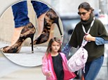 She won't blend in with those! Katie Holmes dashes around in camouflage high heels while taking Suri to school