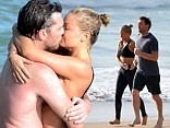 When Lara Bingle and Sam Worthington couldn't get any cuter, they decided to share a PDA on Sydney Beach.