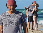 Robert Rodriguez, films himself and his girlfriend kissing on his iphone in Miami Beach