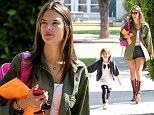 Alessandra Ambrosio picks up her daughter Anja looking every inch the supermodel