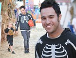 Pete Wentz gets into the Halloween spirit a little early wearing a skeleton hoody to Mr. Bones Pumpkin Patch with his son Bronx