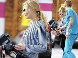 Damsel in distress Kirsten Dunst struggles at the petrol pump but gets a helping hand