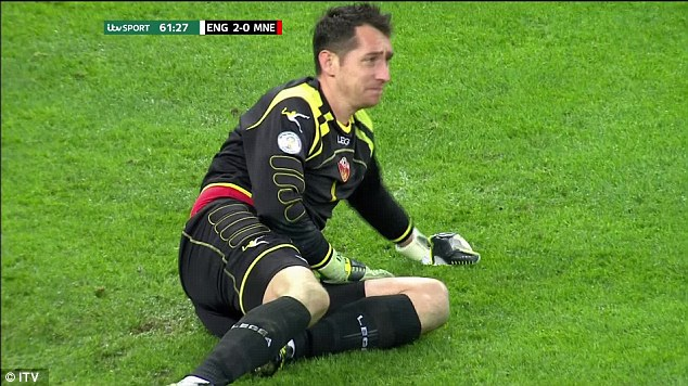 Dry your eyes: Montengero keeper Vukasin Poleksic looks close to tears after conceding an own goal by Branko Boskovic
