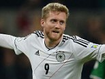 Two good: German's Andre Schuerrle celebrates scoring the second goal