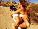 Piggy back: Cheryl Cole gets a helping hand while shooting her 2014 calendar