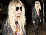 A Pretty Reckless life! Taylor Momsen puffs on a cigarette as she stumbles out of rock club after gig in Los Angeles