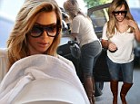 Kim Kardashian provides welcome distraction from family drama in skintight jeans as she heads to dinner with baby North and mother Kris