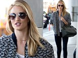The world is her catwalk! Rosie Huntington-Whiteley wows in a suitably stylish outfit as she prepares to jet out of LAX