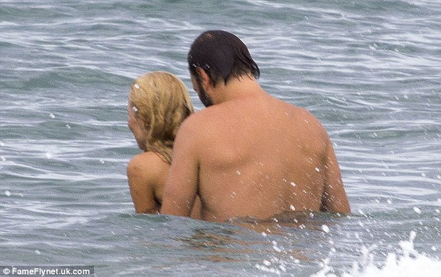 Reunited and it feels so good! The couple enjoy a hug in the ocean as they enjoy a holiday together in the South of France last week