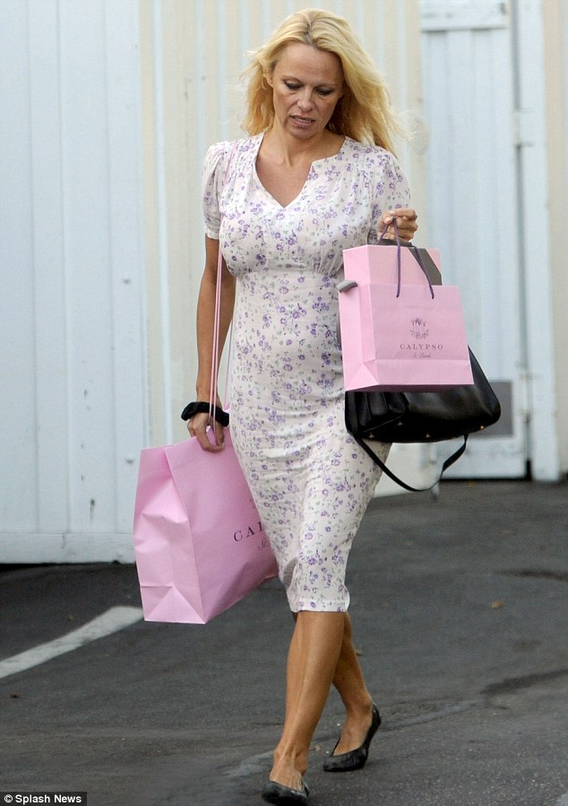Elegant: Pamela Anderson looks unusually demure in a ladylike outfit as she shops in Los Angeles on Thursday