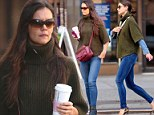 She is making the most out of that outfit! Katie Holmes recycles sweater and jean look on coffee run in New York