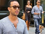 A boot-iful sight! Chrissy Teigan dons thigh high boots as she walks the dog with husband John Legend