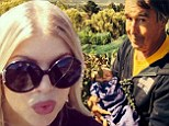 'Grampa's favourite bundle!' Fergie's dad Pat cradles baby Axl Jack while she picks grapes with Josh Duhamel at the family vineyard