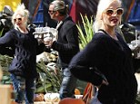 'Pregnant' Gwen Stefani can't disguise her growing baby bump as she carves out some family fun at the pumpkin patch