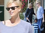 Charlize Theron treats son Jackson to a train ride at the museum... as she sports bandage following neck surgery