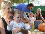 Tori Spelling encourages cute one-year-old son Finn to walk on his own during family day out at pumpkin patch