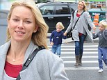 After-school fun! Makeup-free Naomi Watts giggles as she dashes across the street with lookalike sons Samuel Kai and Alexander