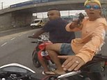 Video shows the terrifying moment a motorcyclist in Brazil is ordered off his bike by a thief who is subsequently shot by a police officer before he gets away