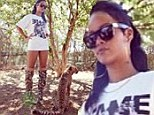 Walk on the wild side! Rihanna wears a tee and camouflage stiletto boots to visit the animals