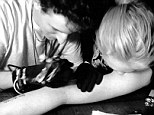 New ink: Lindsay Lohan posted a picture Sunday of her getting a new tattoo