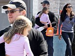 Matt Damon carries his youngest daughter across the street Friday in Los Angeles while chatting with wife, Luciana