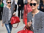 Olivia Palermo performs errands in New York Sunday wearing a fashionable melange of ripped jeans and black patent leather oxfords