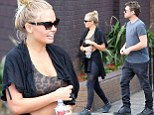 Lara Bingle shows why Sam Worthington can't stay away as she displays toned midriff in sports bra for their gym date