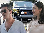 Just your average couple! Simon Cowell and pregnant girlfriend Lauren Silverman share tender moments at lunch and at the grocery store