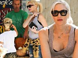 'Pregnant' Gwen Stefani conceals her belly with animal print sweater during pumpkin patch playdate with her sons