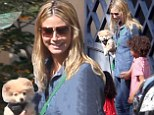 Dog day afternoon! Heidi Klum goes casual in denim as she cradles her Pomeranian pup at children's party