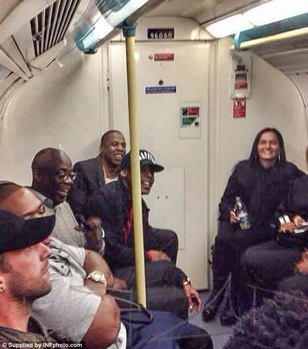Unexpected: Jay-Z, Chris Martin and producer Timbaland gave commuters a surprise as they took the Underground