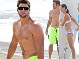 Shirtless Tim Tebow seems carefree as he enjoys the Hawaii surf with sister while the search for a new NFL team continues