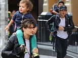 Get a grip! Orlando Bloom hoists his adorable son Flynn for a ride atop his shoulders during New York stroll