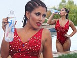 Model Carmen Ortega poses in racy spiked swimsuit and braids