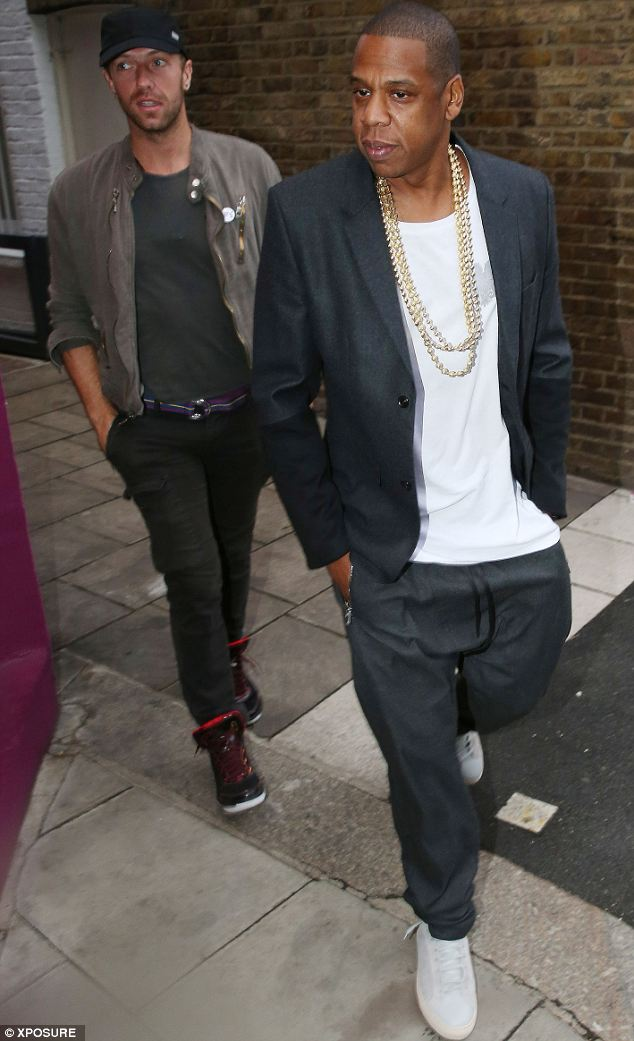 On foot: Chris Martin and Jay Z were seen walking around London on Saturday before catching the tube