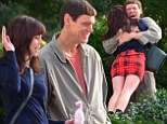 What a Carey on! Jim gives co-star Rachel Melvin a meaty hug on set of Dumb and Dumber To