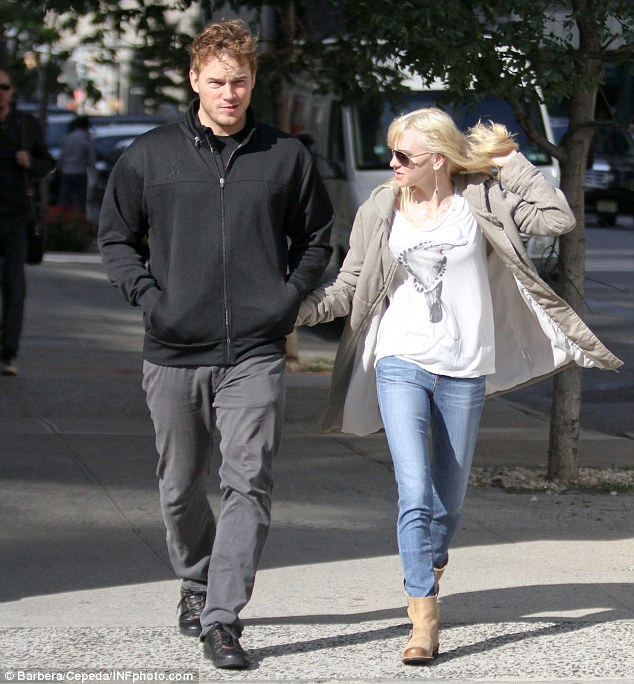 Can't get enough: Anna seemed to be preoccupied with her tangled tresses as Pratt strolled forward