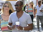 The distinguished gentleman! Eddie Murphy holds girlfriend Paige Butcher's hand and opens the car door for her as they go on their daily coffee run