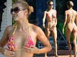 She just loves to show it off! Joanna Krupa bared her bikini body at the pool with her husband Romain Zago in Miami, Florida on Monday
